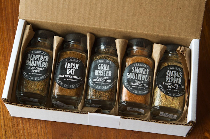 five spice bottles in a box. The flavors are peppered habenero, fresh bay (for seafood), grill master, smokey southwest, and citrus pepper. Hungry yet?