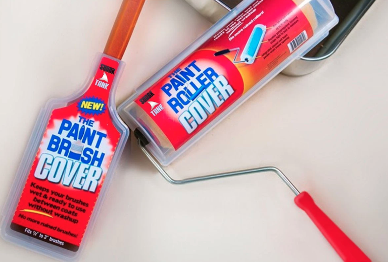 the plastic cover on a paint brush and another cover on a roller