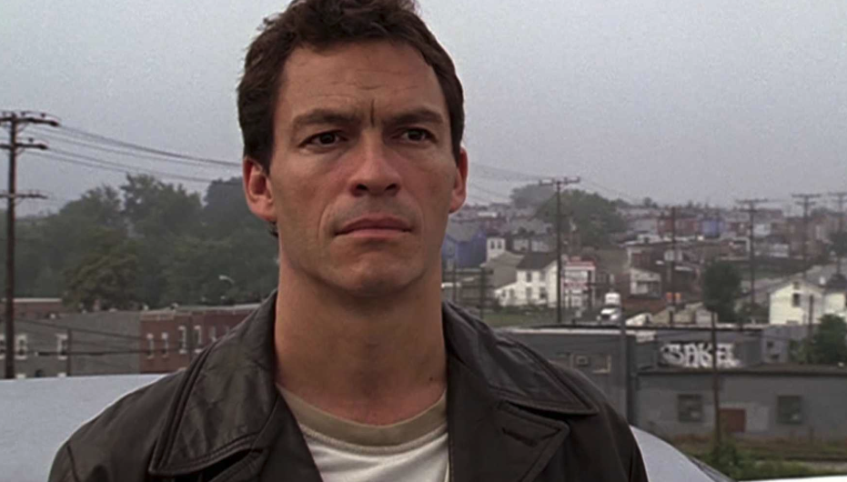 """Dominic West standing outside in """"The Wire"""""""