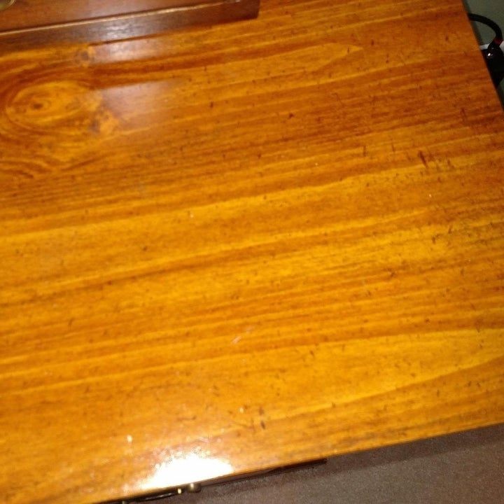 The same wooden table looking shiny with no discoloration.