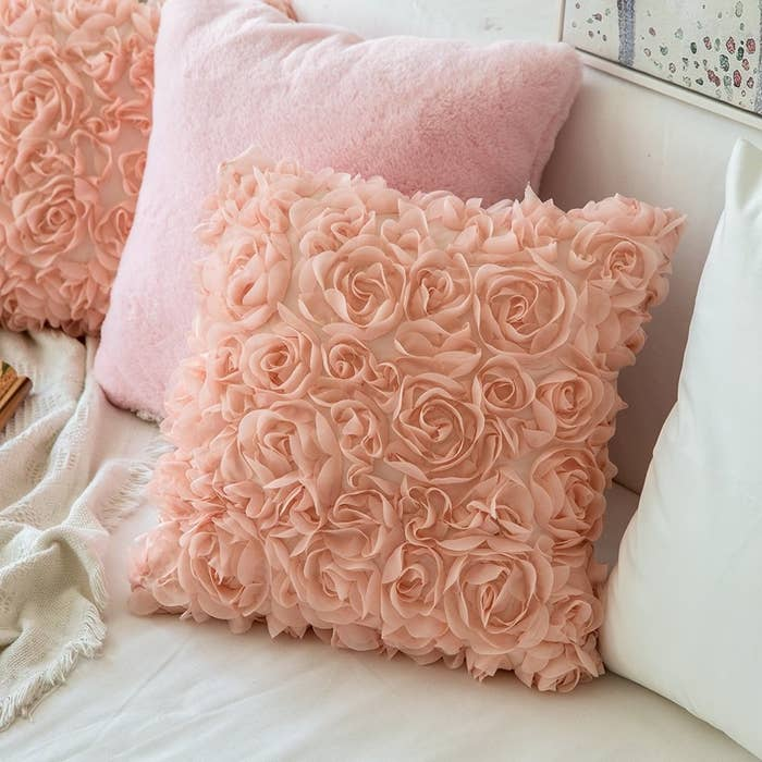 square pillowcase with raised fabric to look like roses all over it