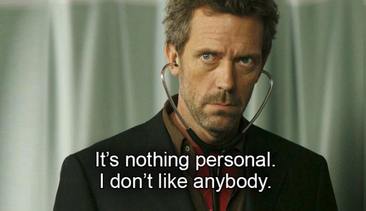 """Hugh Laurie with a stethoscope in his ears on """"House"""""""