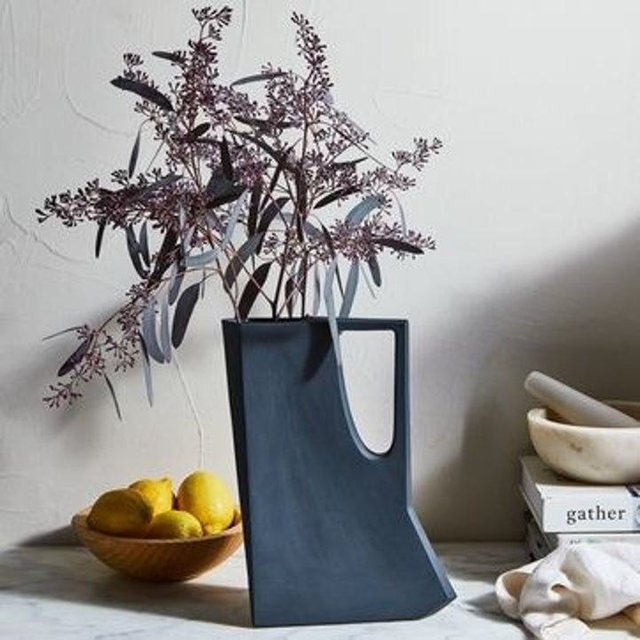 the pitcher being usd to hold flowers