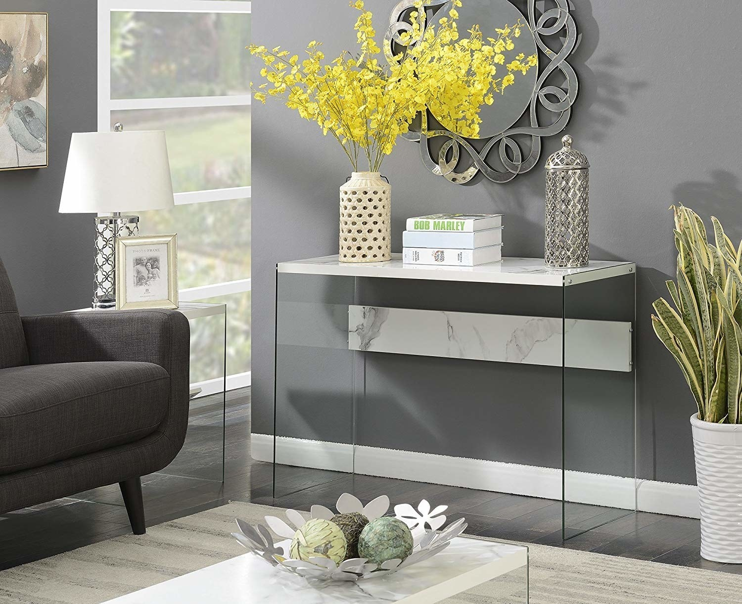thin marble-top table with clear legs