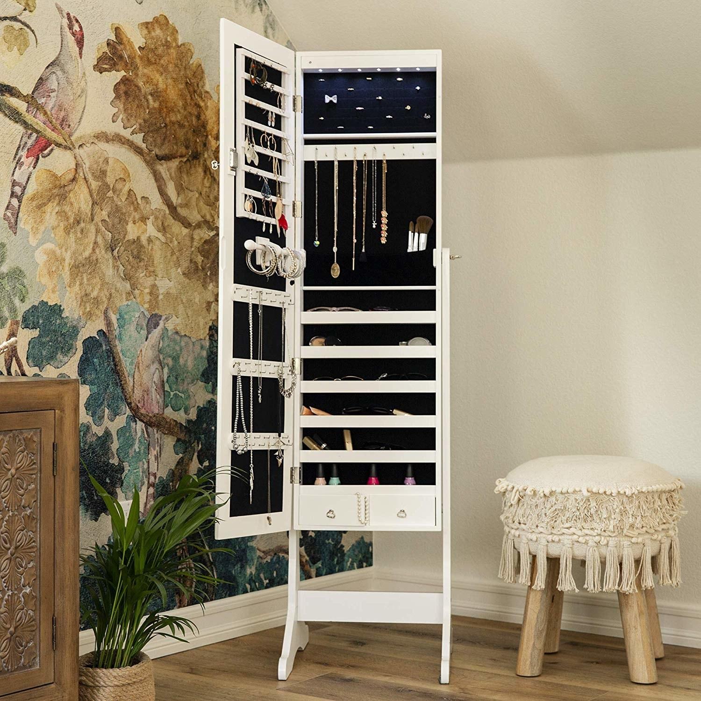 The white mirror open revealing storage options
