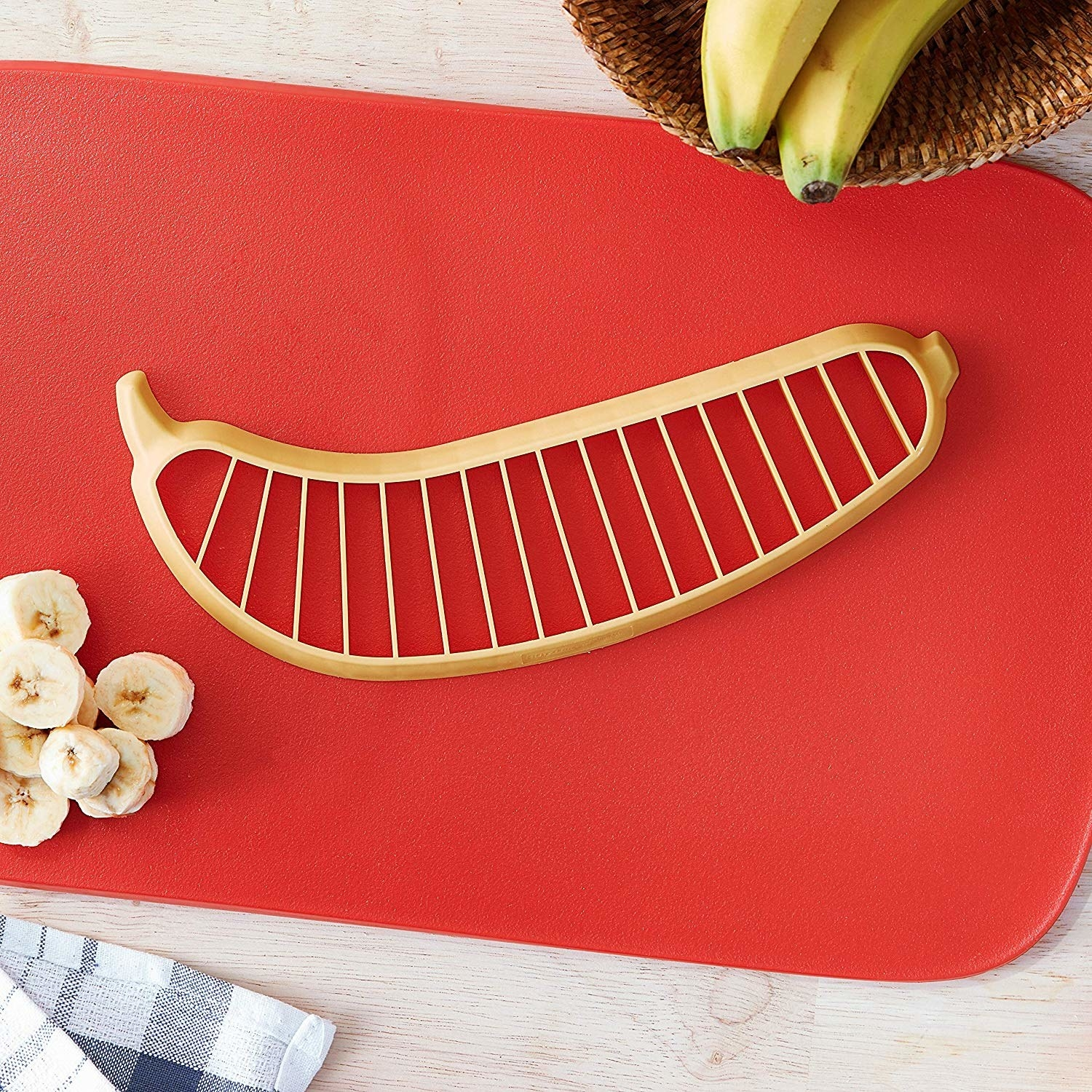 The banana slicer on a cutting board
