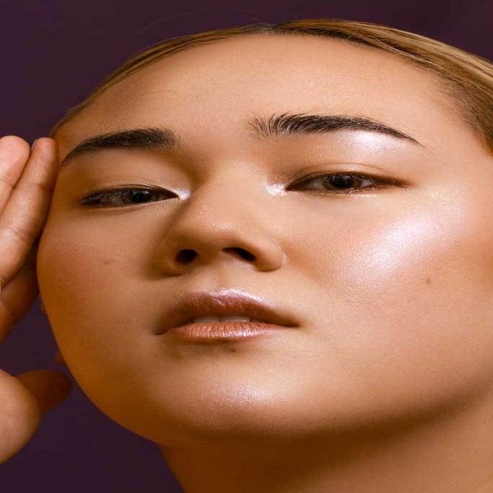 model wears shimmer on cheeks