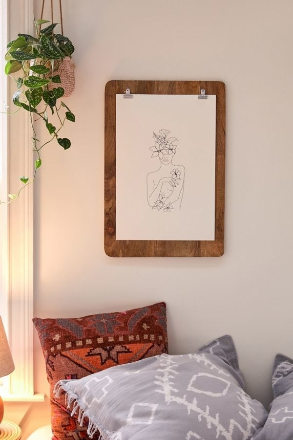 rectangle clipboard frame in dark wood on a wall