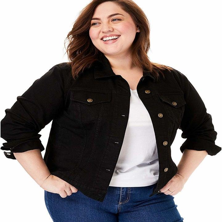 a model wearing the jacket in black denim