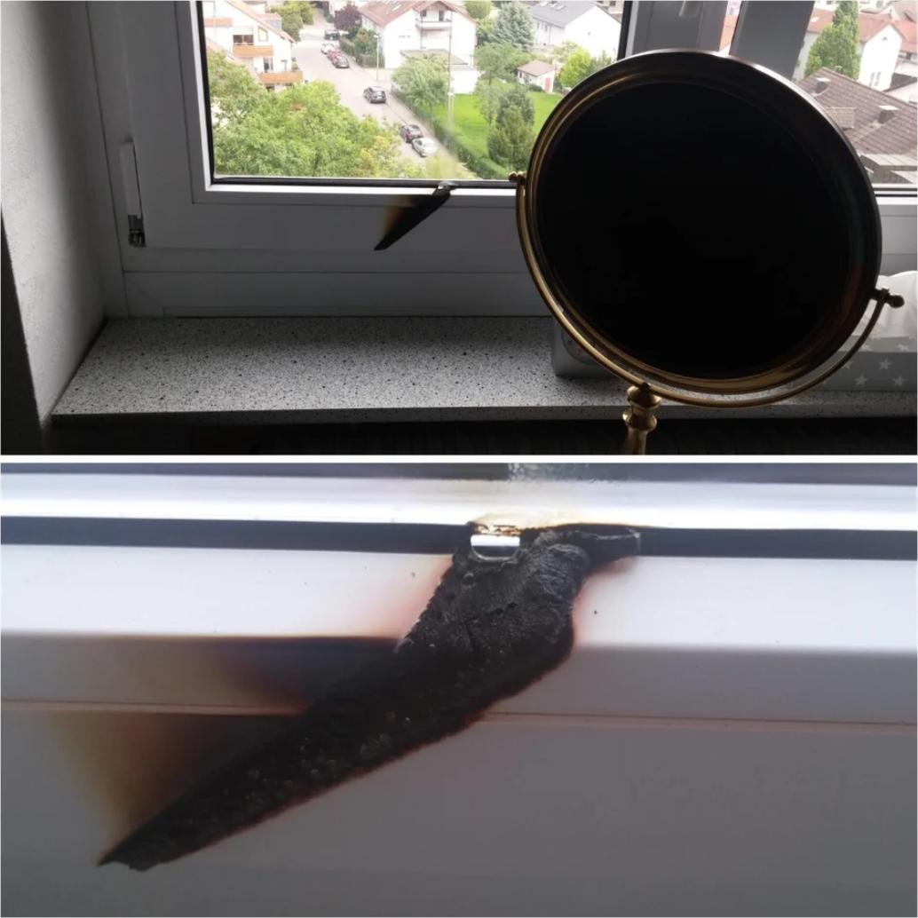 A blackened mirror on a windowsill and a burnt shelf