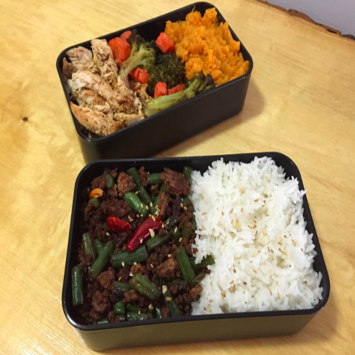 Bento box filled with rice and veggis