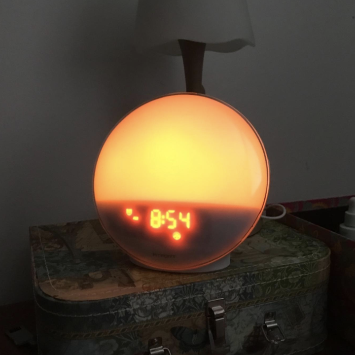 a reviewer's rounded alarm clock glowing slightly