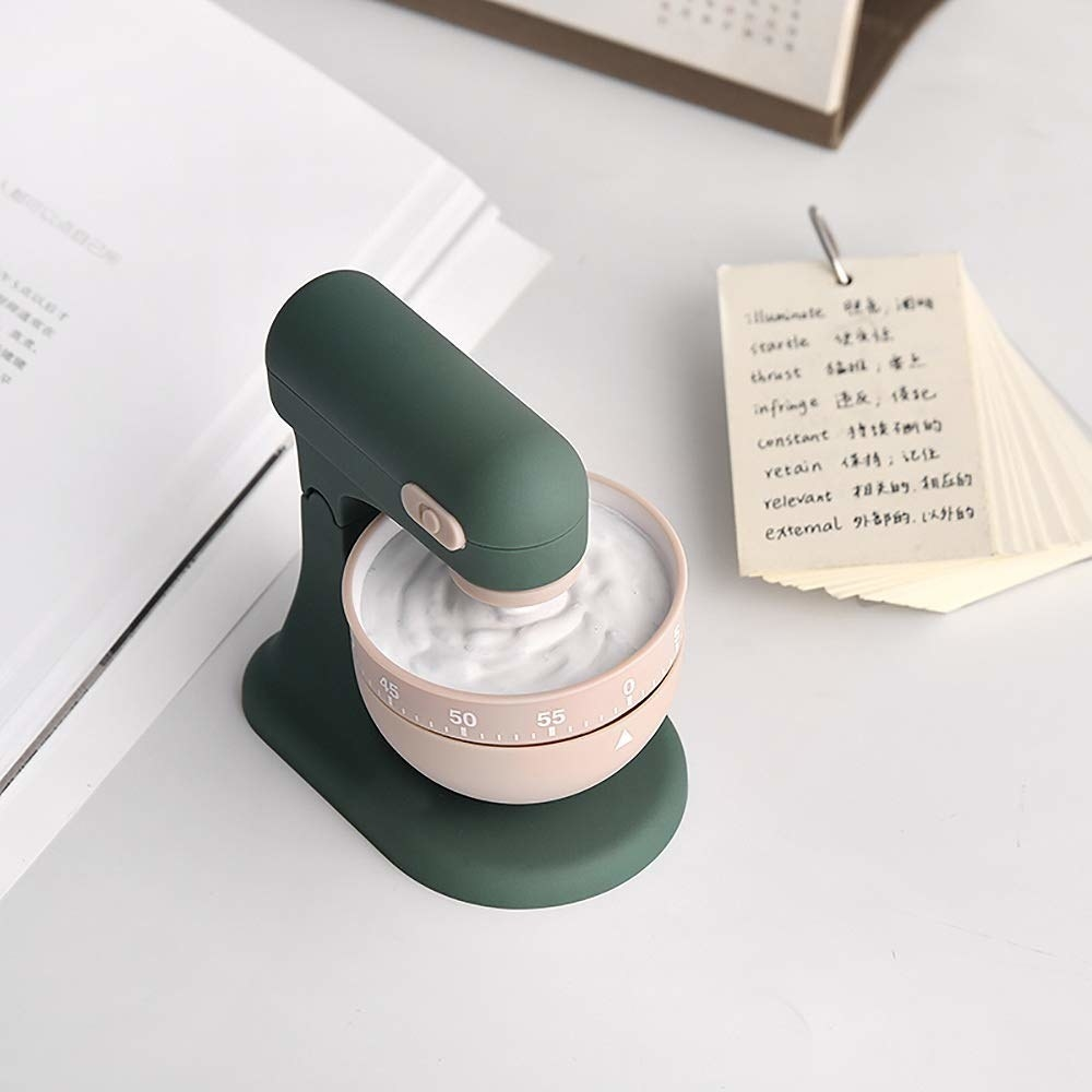 a small green timer that looks like a stand mixer