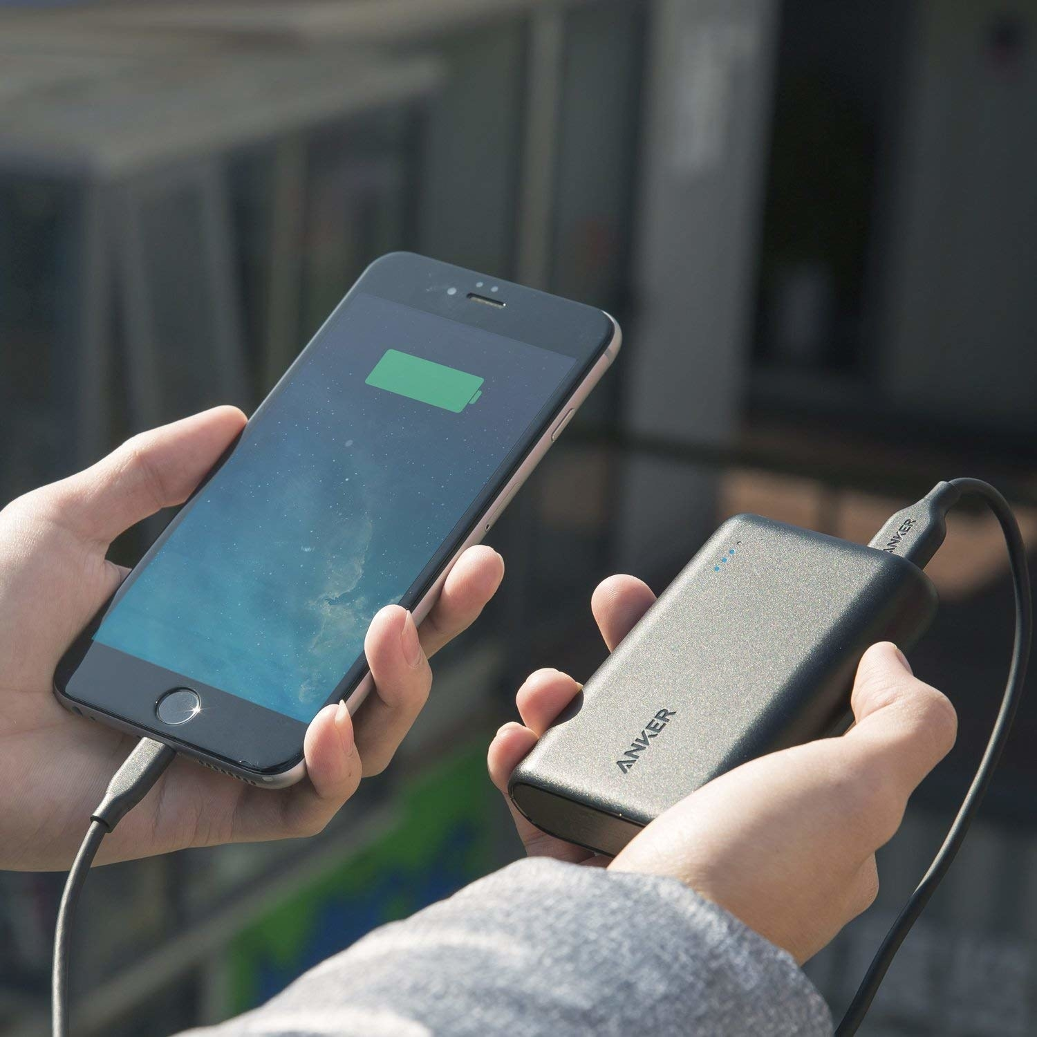 the anker charging bank charging a phone