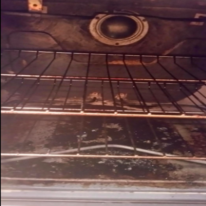 reviewer pic of nasty looking inside of oven with lots of burnt baked on food