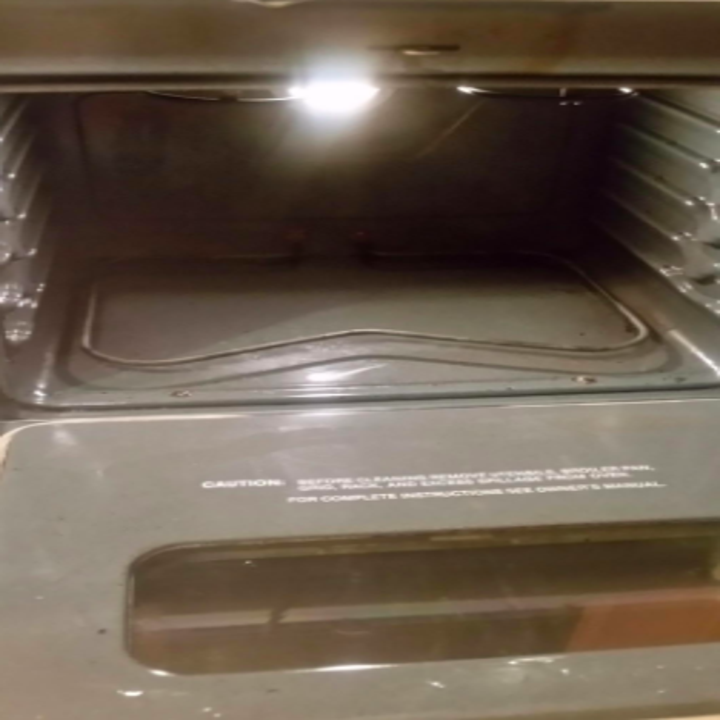 reviewer pic of the same oven looking nearly new with none of the baked on mess