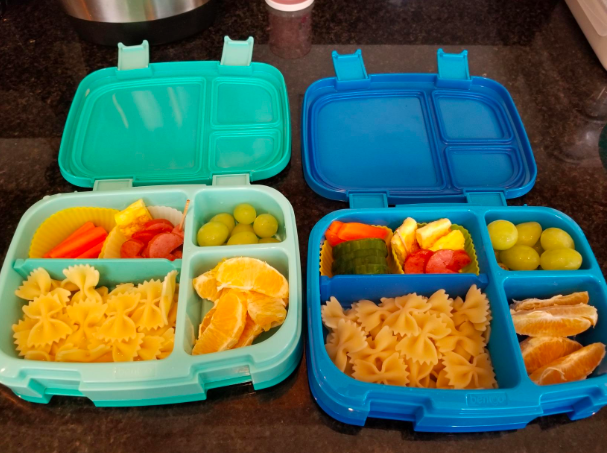 a reviewer photo of two bento boxes filled with pasta, fruit, and other foods
