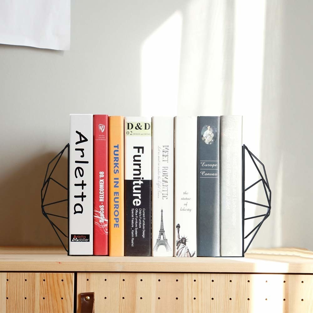The bookends with several large books between them