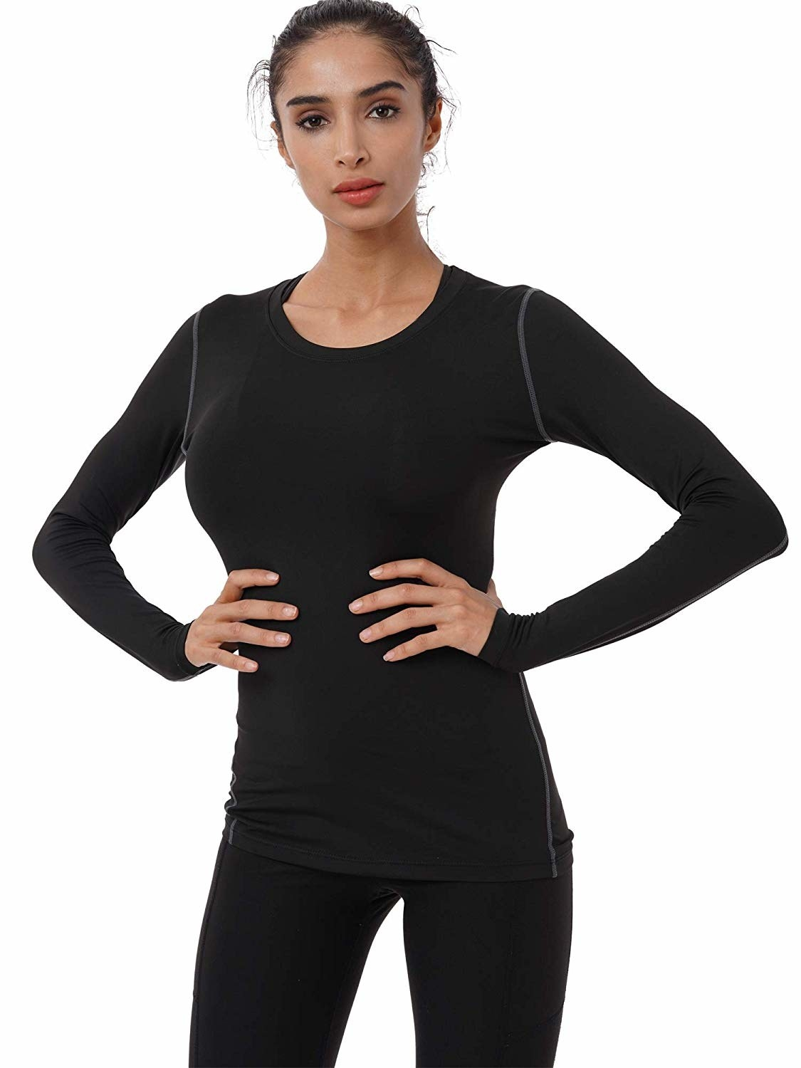 a model wearing the compression shirt in black