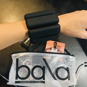 a reviewer wearing the bracelet weights in black