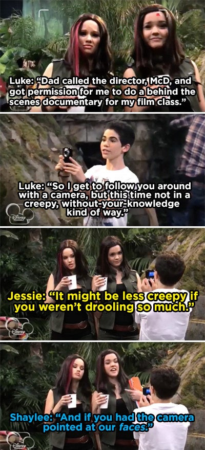 Luke pointing his camera at Jessie's chest