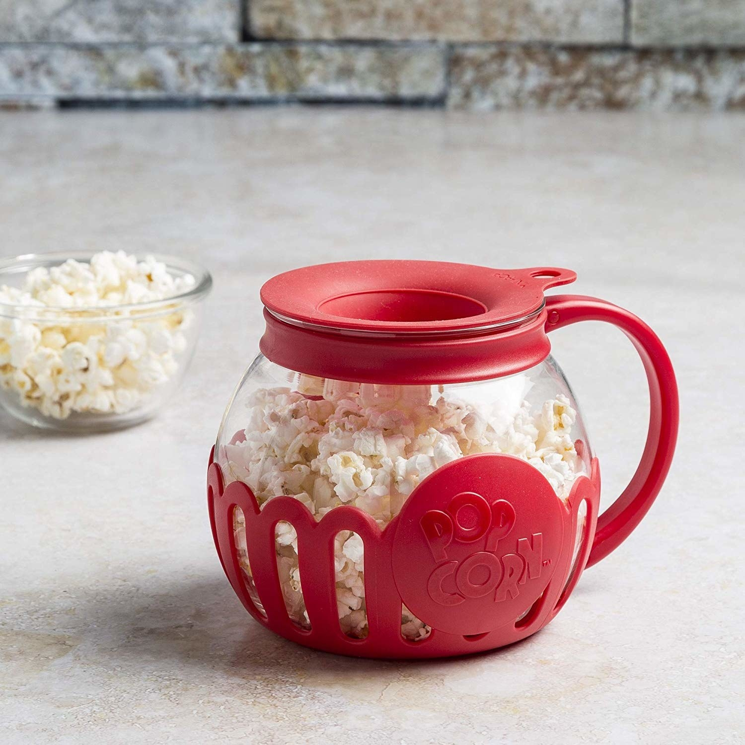 A large mug that's lined with silicone and has popcorn inside