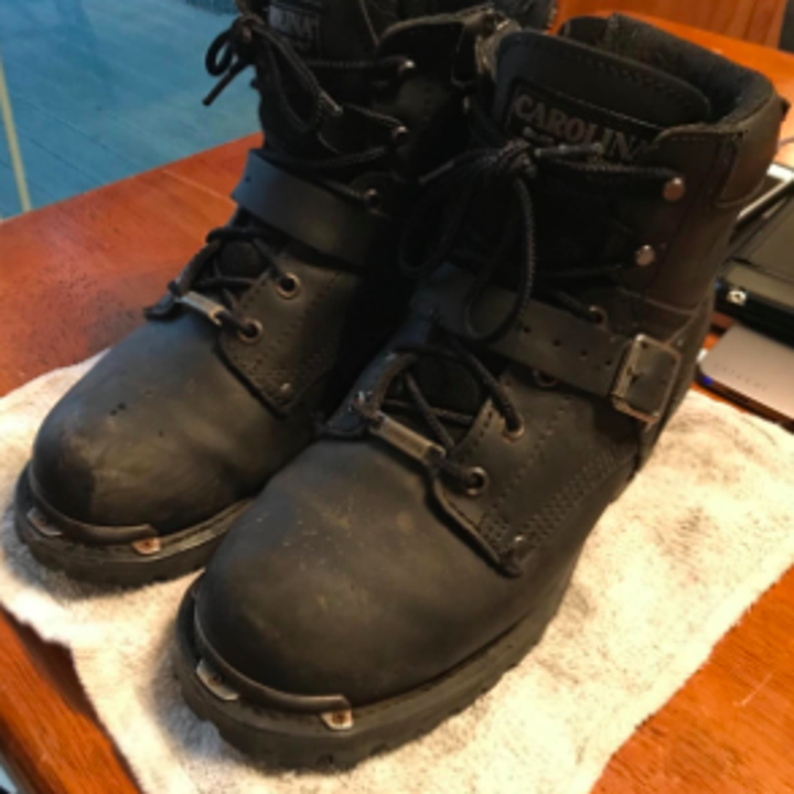 reviewer pic of very worn black leather boots