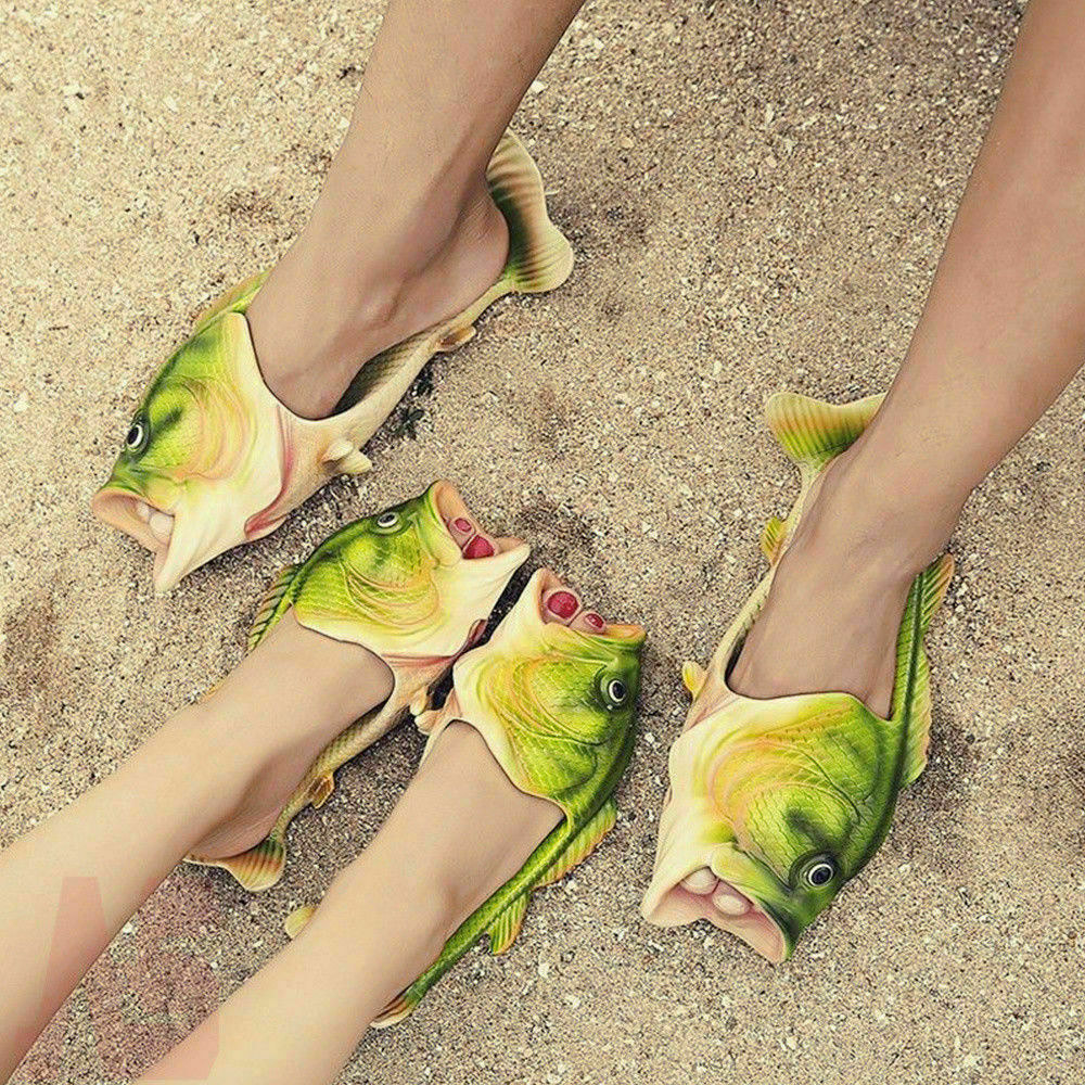 Two people wearing fish slides at the beach