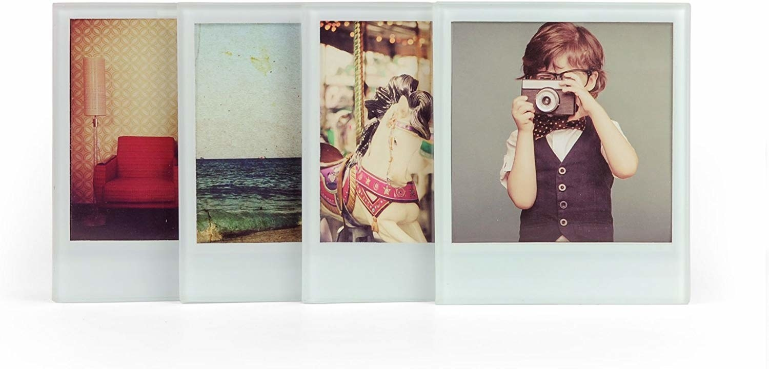 A set of four glass coasters with instant photographs inside