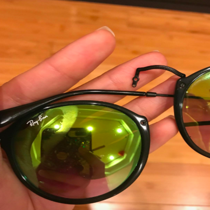 reviewer pic of how the sunglasses were broken with the nose bridge detached