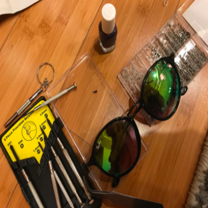 reviewer pic of sunglasses with the repair kit