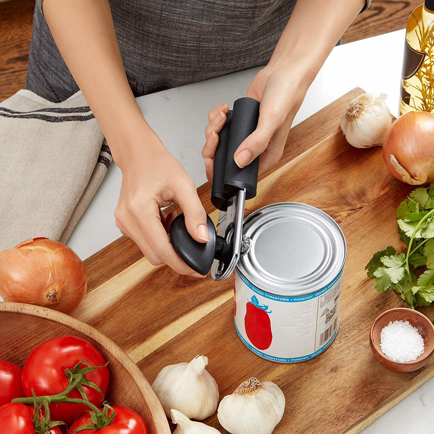 A person using the can opener