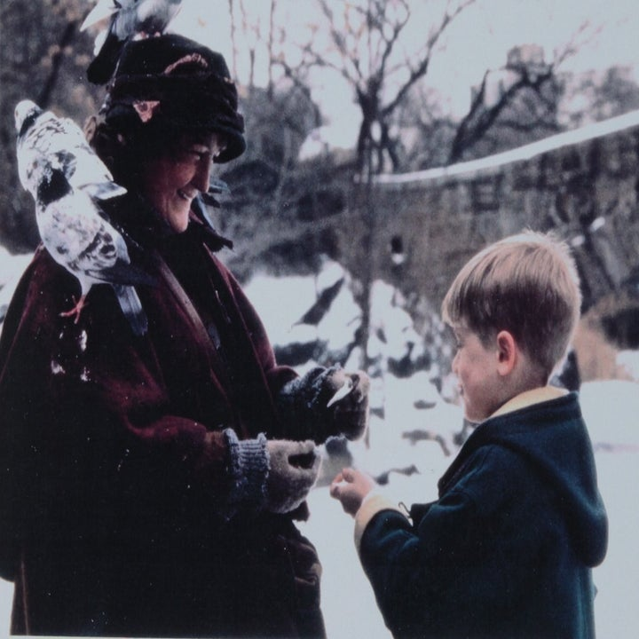 still from the movie showing kevin giving one of the ornaments to the pigeon woman