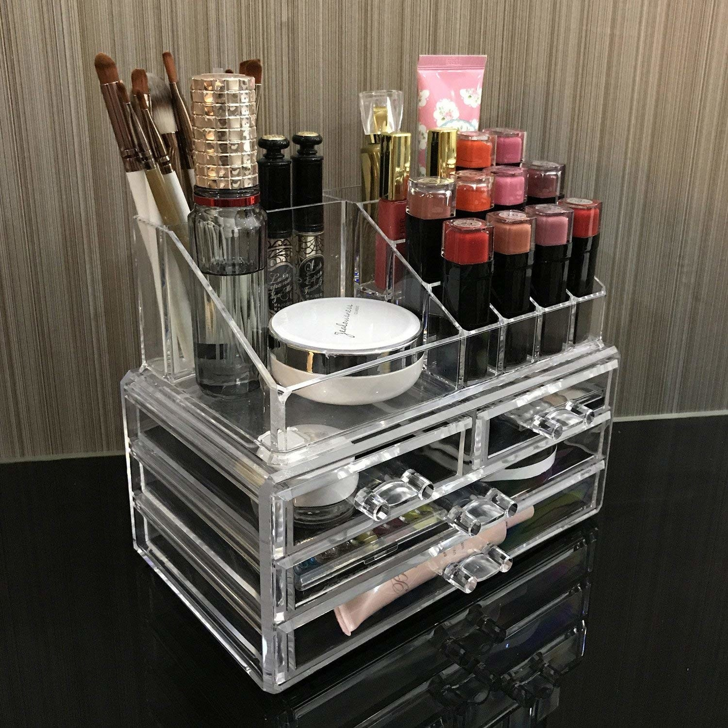 clear organizer with three drawers and lipstick and other storage on top
