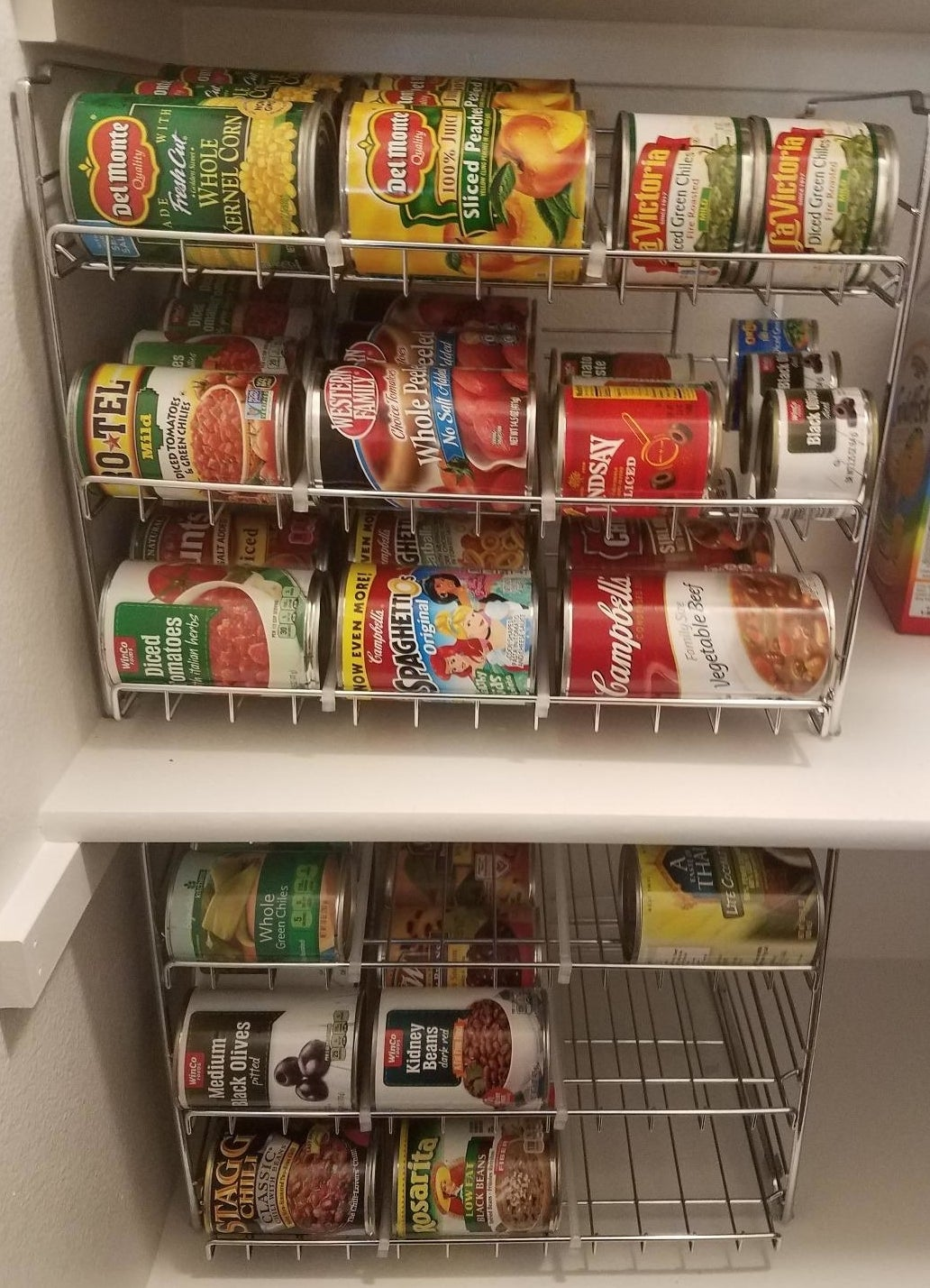 Reviewer's pantry with two of the metal wire racks, which are full of cans