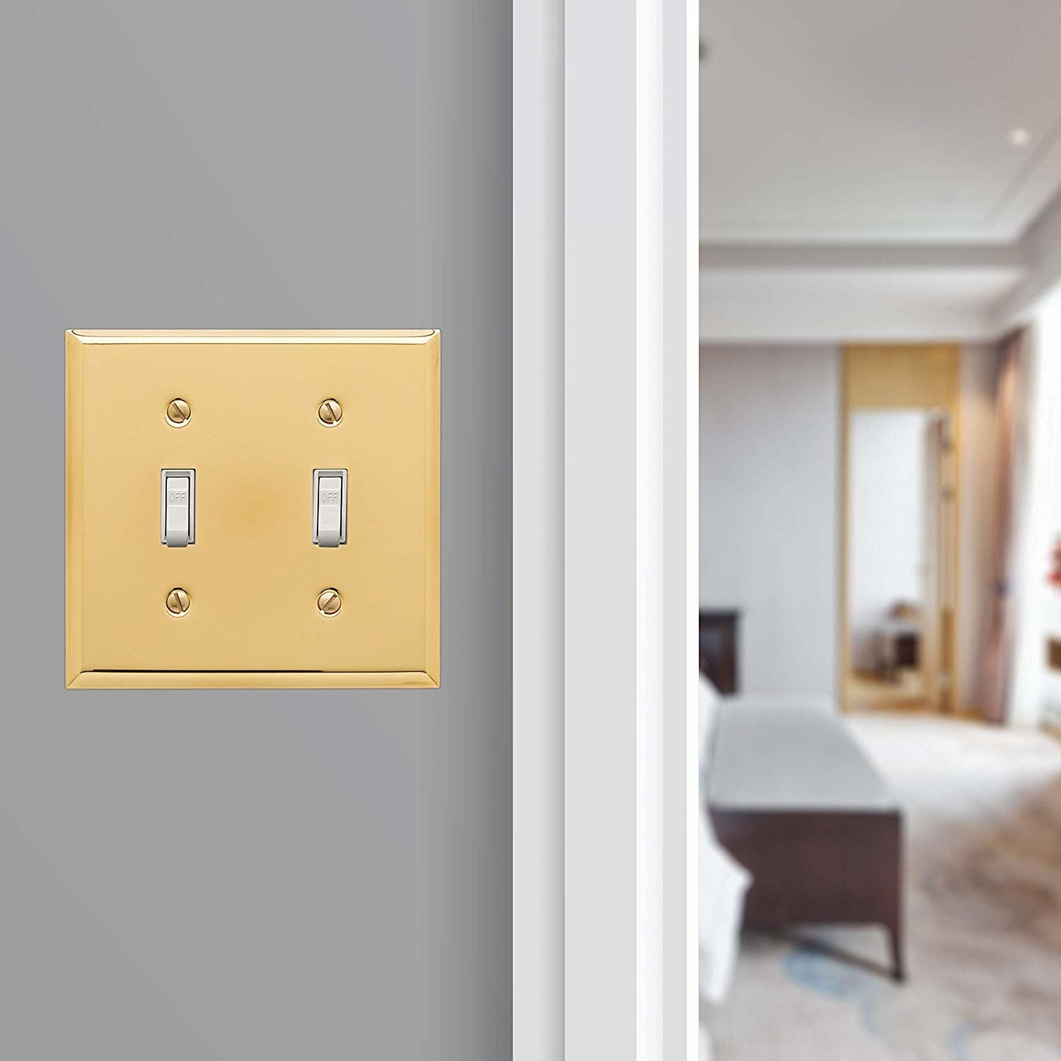 The gold cover over double light switches