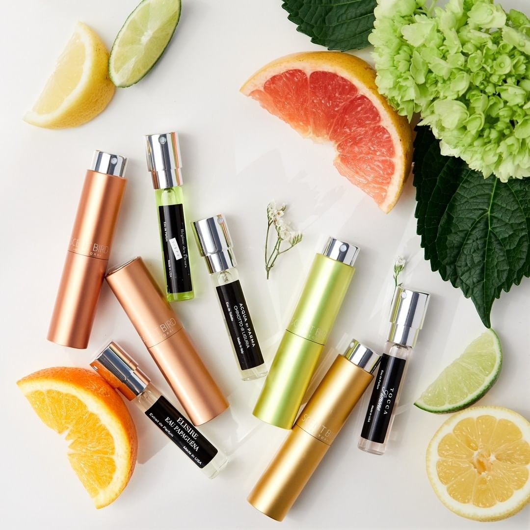 colorful mini perfumes next to slices of fruit