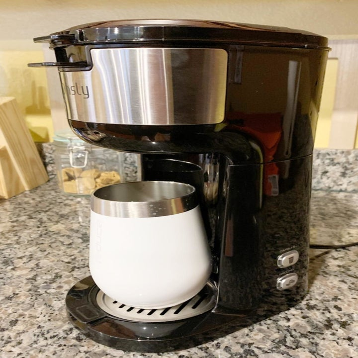 Another reviewer photo of the coffee maker and a travel mug