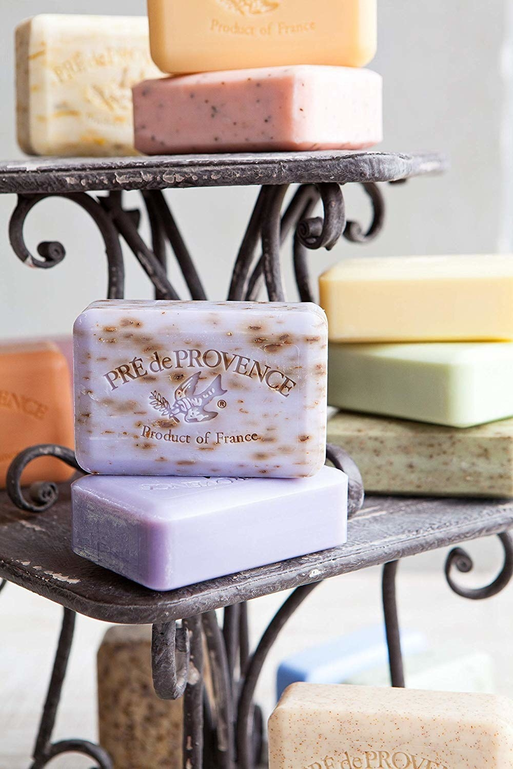 "A stack of the colorful soaps engraved with a bird and ""Pre de Provence product of France"" logo"