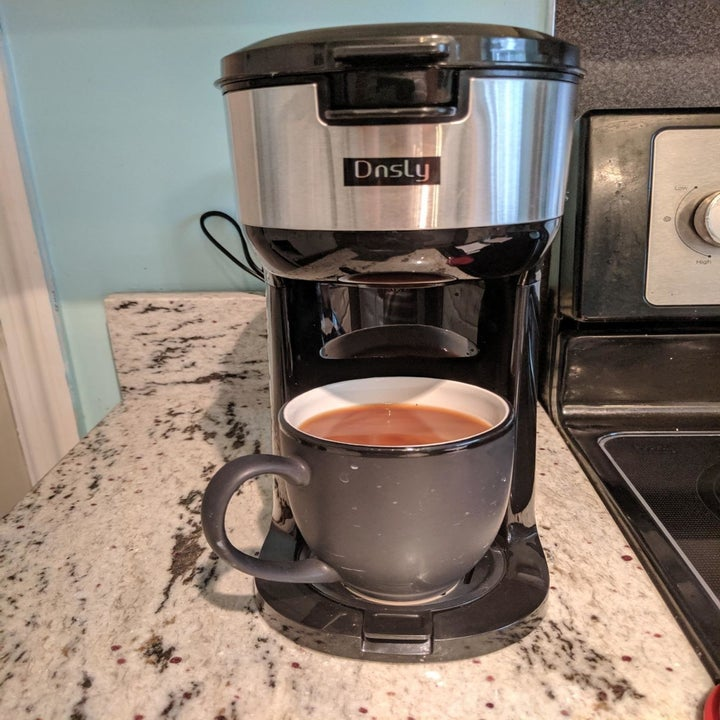 Reviewer photo of the coffee maker and a freshly brewed cup of coffee
