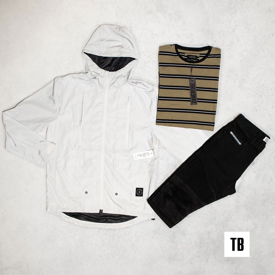 a pair of black pants, a striped shirt, and a white jacket