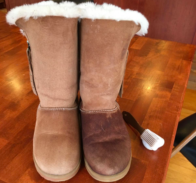on the left, an ugg boot looking clean after using the brush, and on the right, the other boot in the pair still looking dirty before using the brush