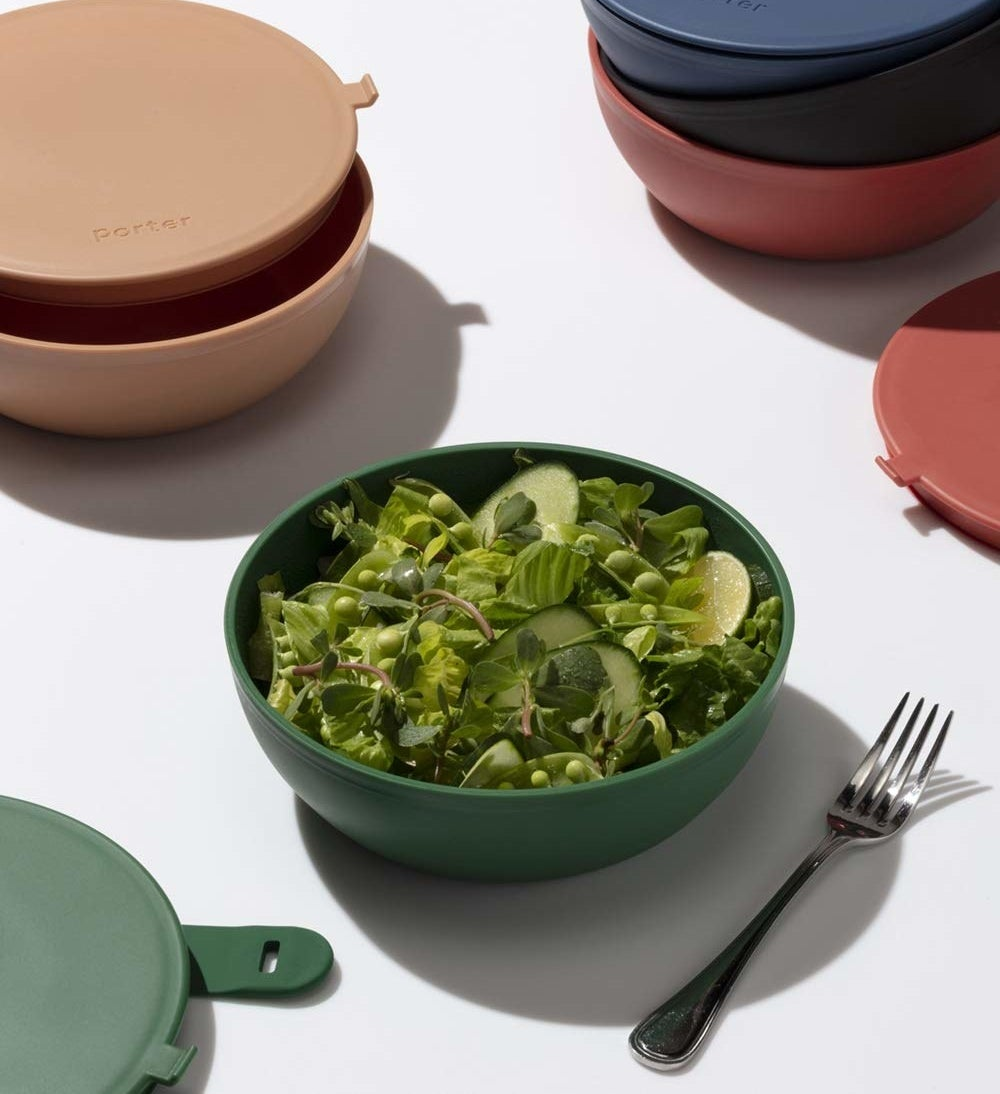 green bowl with lid full of salad