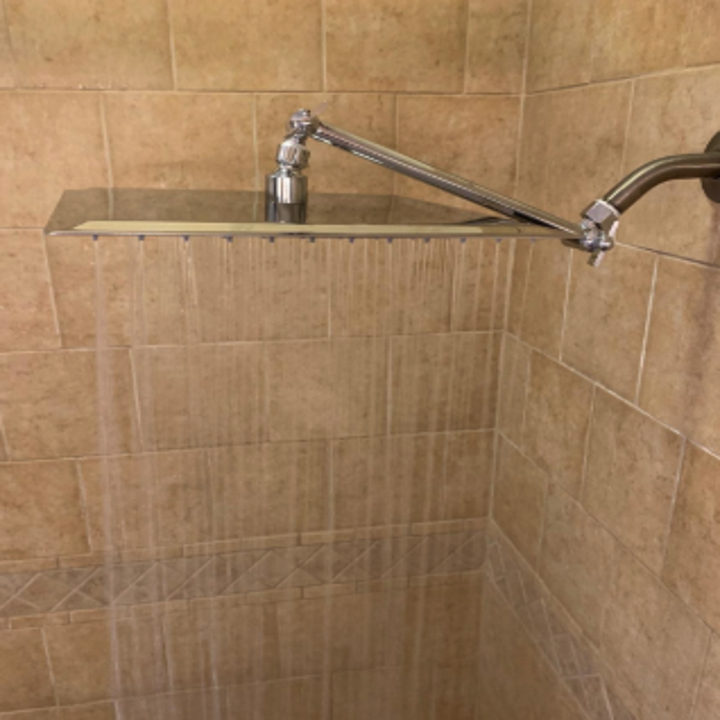 Reviewer image of the shower head with rain-like water pouring out of it