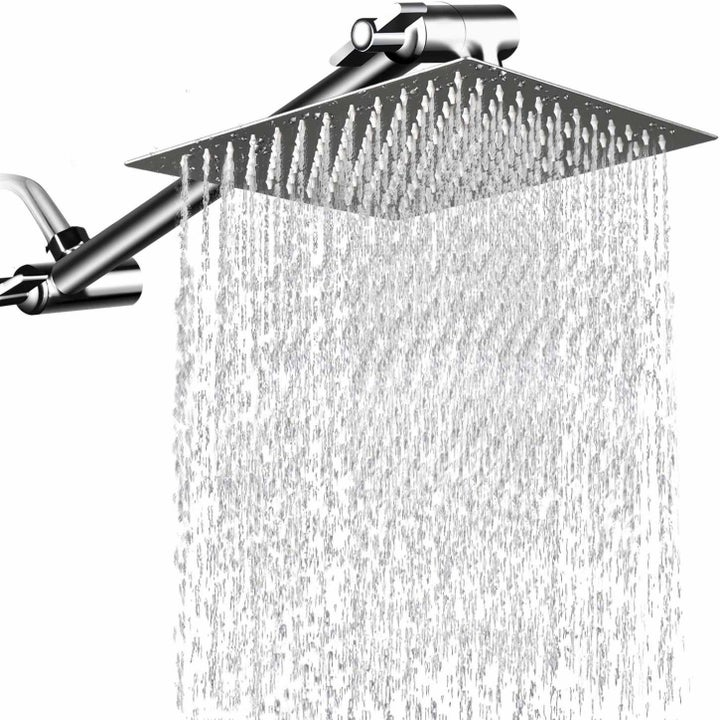 The shower head with rain-like water pouring out of it