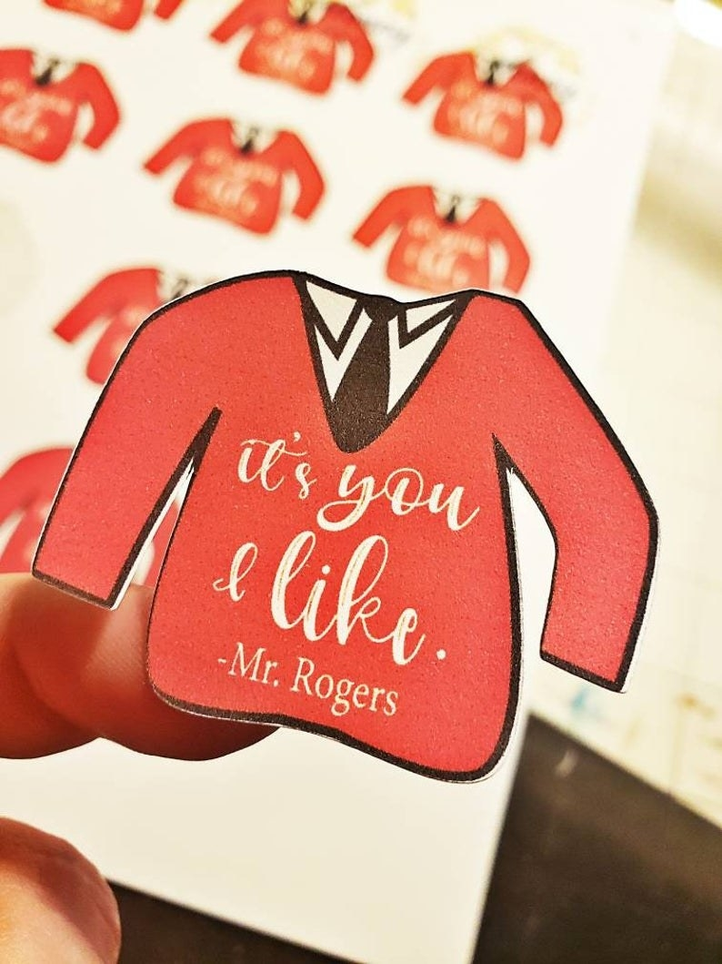 """Sweater-shaped sticker that says """" It's You I Like. – Mr. Rogers"""""""
