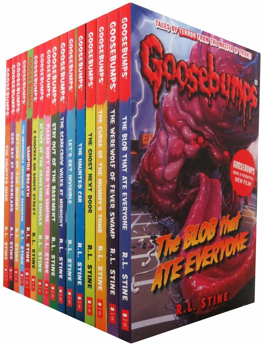 "The spines of all the books listen below, showcasing the cover of ""Goosebumps: The Blob that Ate Everyone"" by R.L. Stine with a scary illustration of a pink, veiny blob with an open mouth, long tongue, and red eyes."