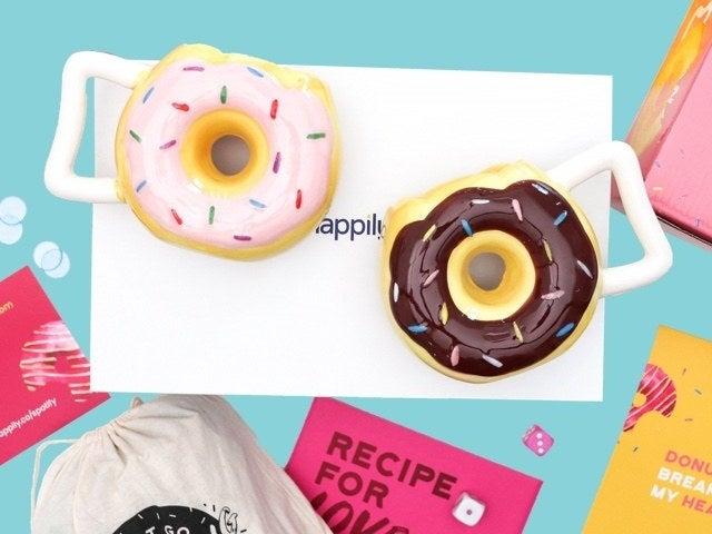 doughnut shaped mugs on a box