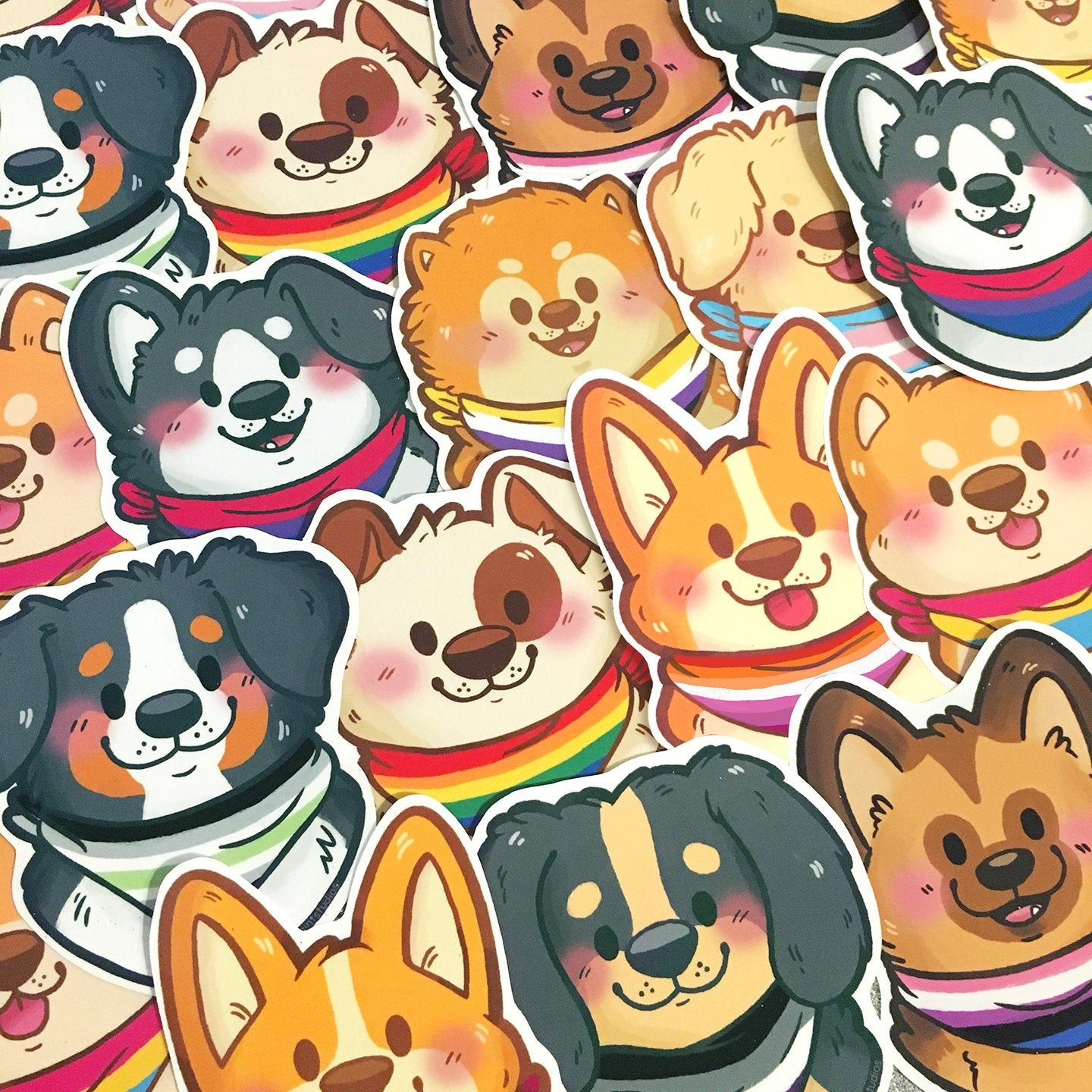 cute dogs with various pride flag bandanas