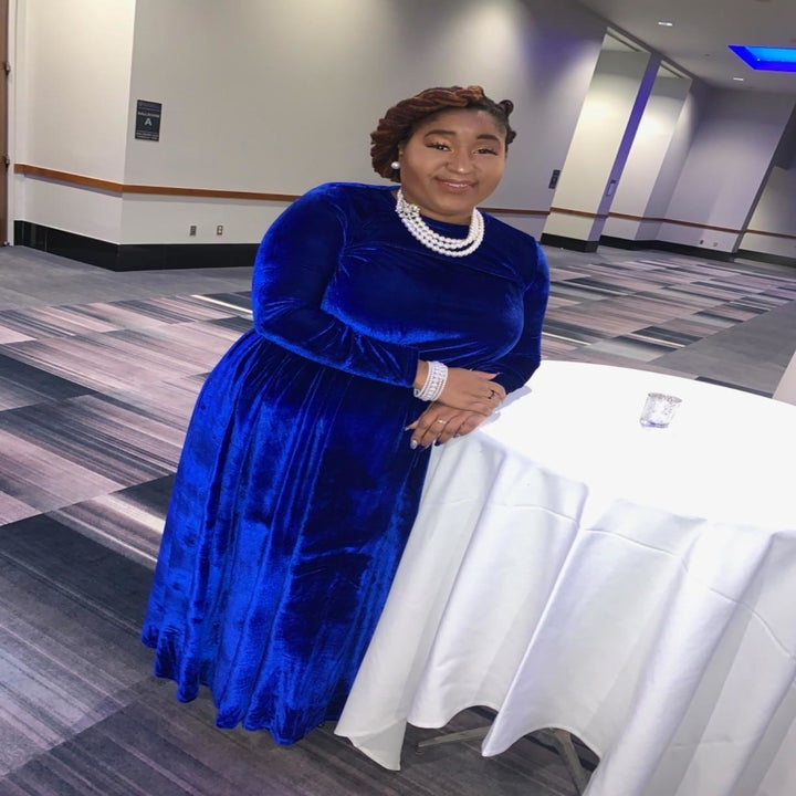 A different reviewer wearing the dress in blue velvet